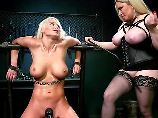 Mistress in stockings mercilessly dominates tanned blonde slave