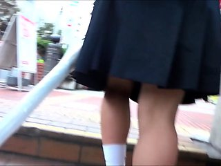 Desirable Oriental schoolgirl in uniform upskirt in public