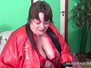 Slutty mature teasing her big tits