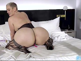 Blonde babe in stockings and lingerie with big ass and tits fingers her toyed pussy in webcam solo