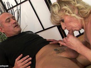 Mature gives blowjob to hot dude