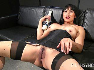 Solo Asian model Mia Little spreads her legs and masturbates