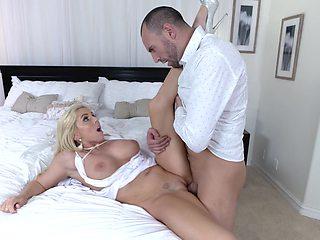 Blonde wife welcomes the next door neighbor for a wild fuck