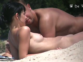 Beach couple making out nude while being voyeur taped