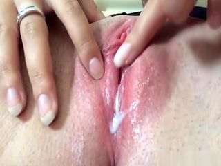 Amateur babe fingers her tight shaved pussy to an orgasm