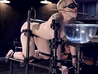 Blonde slave with gas mask tormented