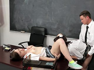 A couple of girls are fucking in front of the blackboard