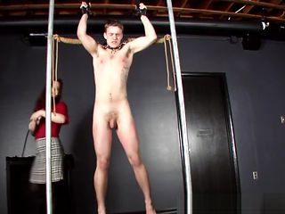 Mistress Whipping her Slave and CBT