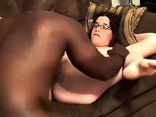 Buxom brunette wife cuckolds her man with a hung black guy