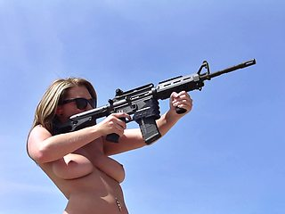Naked pornstars shooting guns and fucking in the desert