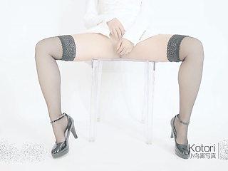 Black silk high heeled with ice cream stick sticky white pul