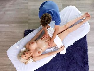 busty beauty gets fucked on the massage table