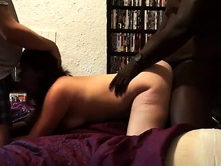 Horny brunette gets involved in a wild interracial threesome