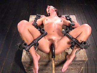Hairy cunt lady toyed in metal device