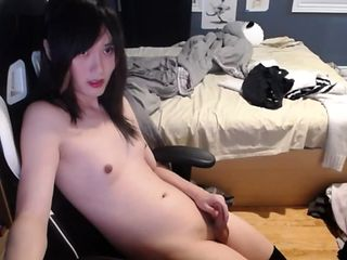 Cute young asian tgirl cums while listening to anime music