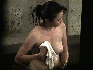 Hot Asian girl takes a bath and puts her big tits on display