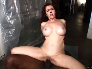 Redhead with big breasts gets humped silly by fuck hungry man in interracial action
