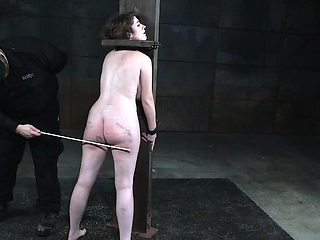 Bound slave punished with pole before flogged