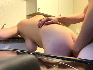 Fucking horny cougar in her kitchen