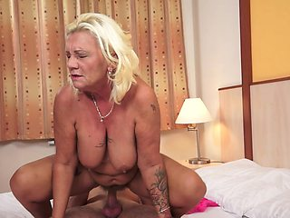 Fat blonde granny with huge titties rides a big pecker so well
