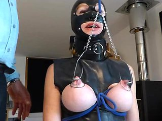 Slave has hooks in tits