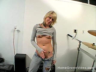 Unshaved girl uses her long fingers and a dildo to please her cunt