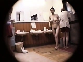 Kinky voyeur spies on lovely Japanese babes in the shower