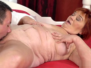 Big ass redhead GILF fucked by a stud half her age
