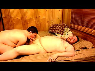 Two chunky gay lovers enjoying hard anal sex on the bed