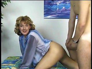 Horny German milf checks a boy and fucks him