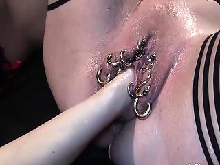 Horny amateur sluts fisting their pierced pussies