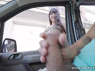 Busty, dark-haired Spanish beauty Alba De Silva is texting on the sidewalk