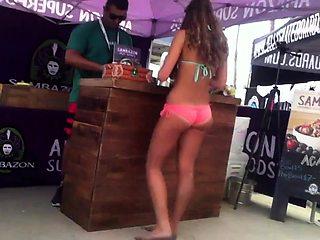Beach voyeur shoots a sexy slender girl in a tight bikini