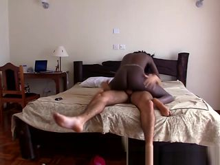 A slutty amateur black girl masturbates before gets hard white penis in her pussy