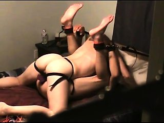 Dominant brunette fucks her horny slave with a strap-on toy