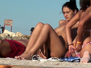 Young Girl with Beautiful Breasts on Nude Beach