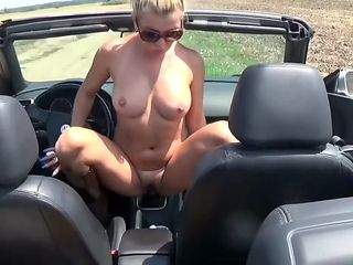 Sexy Blonde riding gear shifter in public place