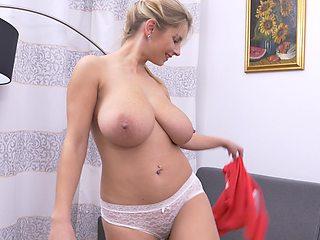 Russian mature Katarina Hartlova spreads her legs to masturbate