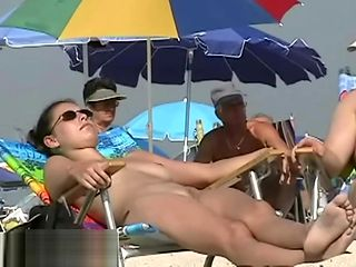 A lovely chick in a nude beach spy cam video