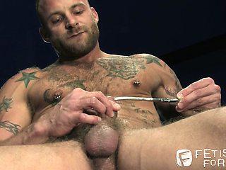 Hairy tattooed stud Derek Parker loves piercings and