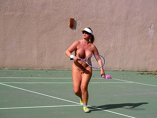 Nude playing tennis