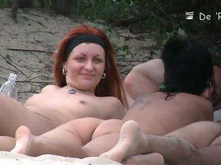 Hot tattooed redhead filmed on a nudist beach