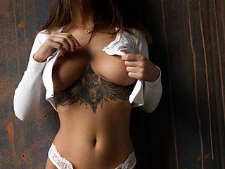 Busty tattooed brunette MedinaQ stripping in HD video