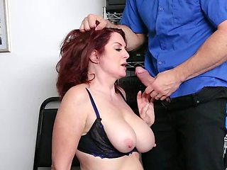 Big-boobied mature redhead has to satisfy security officer's dick