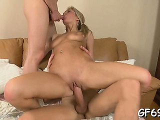 Nice-looking girl is entertaining 2 wild and horny hunks