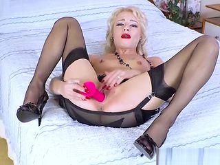 Horny blonde wanks pink sex toy in retro nylons garters heels
