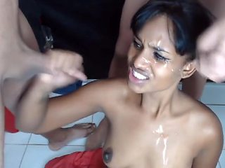 Smiling Teen takes gang facial from guys jerking off on her