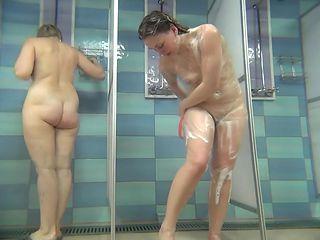 Hidden Cam Records Mature Women Taking A Shower