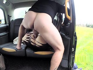 Babe in fishnets gets anal in fake taxi