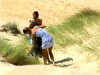 Beach voyeur finds naughty amateur babes under the hot sun